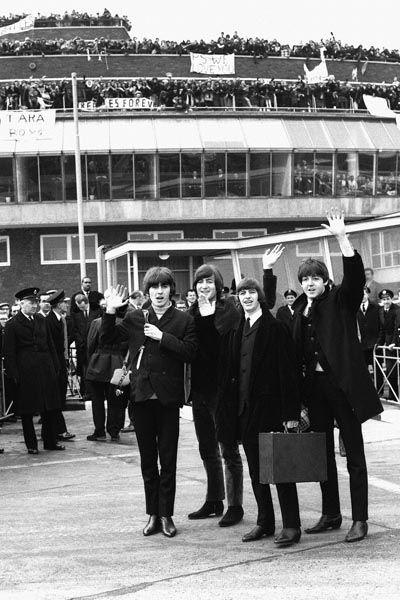 030. постер: The Beatles в Америке